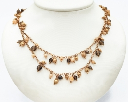 Srebrna ogrlica topaz in korala