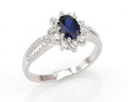 Srebrn prstan LOVE BEAM z modrim safirjem in cirkoni