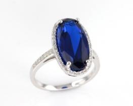 Srebrn prstan LOVE SMILE Oval z modrim safirjem in cirkoni